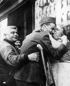 Private Sam Macchia, a New York boy who has seen service since 1942, and has spent 17 months overseas, returns home, wounded in both legs, to his elated family. (Photo by Keystone/Getty Images)