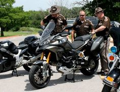 I learned a lot about motorcycle safety and accidents today. Troopers look at new motorcycles for a safety and educational program  Thursday at the Oklahoma Department of Transportation Training Center.  Photo by Tiffany Gibson, the oklahoman