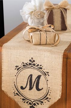Monogrammed table runner on burlap & burlap wrapped packages