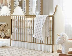 I love the Gold Dot and matches the venetian gold iron crib in her room!