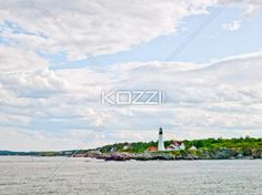 Lighthouse and Cloudy Sky - A lighthouse infront of a cloudy sky in Portland