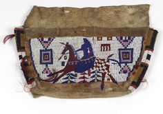 Tsitsistas / So'taeo'o (Cheyenne) beaded tipi bag, ca. 1880. Montana. Seed beads, horsehair, tin cones, feathers, porcupine quills, pigment, hide, and sinew. (10/9612)