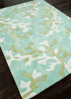 Style and value strike a perfect balance in Coral Fixation, a gorgeous sea turquoise, green and white coral branch area rug.