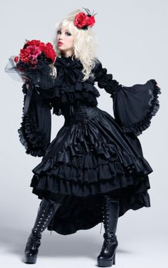 Poofy dress with ruffles and bell-sleeves.  And her boots!