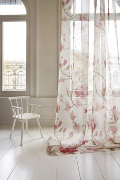 Fischbacher Magnolia; romantic floral transparent curtain in a spacious white room;