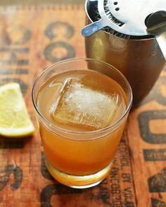 the gold rush:  3 tablespoons honey 2 tablespoons boiling water 1/2 cup (4 ounces) bourbon  1 1/2 lemons, juiced, about 4 tablespoons (2 ounces)