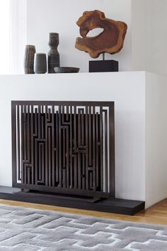 A cool fireplace screen could be a great focal point below the painting or mirror!  You said it yourself...  You will probably never light the thing!