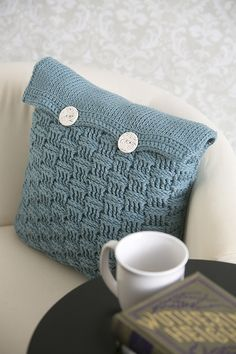 Frozen Crystals Pillow - This texture-rich pillow cover is a feast of crochet stitches: post stitches form the basket weave and Tunisian knit stitch provides the counterpoint. Find some great yarn, add decorative buttons, and you've got yourself a wonderful new look for your home. From the February 2015 issue of I Like Crochet.