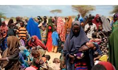 Somalian refugees gather outside a food distribution point at the world's biggest refugee camp in Dadaab, Kenya. Photograph: Roberto Schmidt/AFP