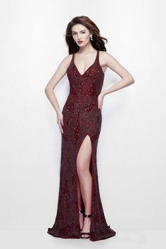 Primavera Look uber chic in this Primavera Couture evening gown. This sleeveless dress boasts of a V-neckline. The bodice is speckled with decadent sparkling detail throughout. The high slit and a dainty straps in a criss cross fashion on the back adds to the look. Available in Burgundy & White.