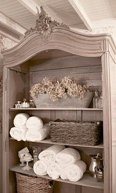 love the distressed armoire in a master or guest bathroom