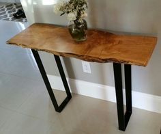 Live edge figured maple Entry table Black powder coated metal legs.