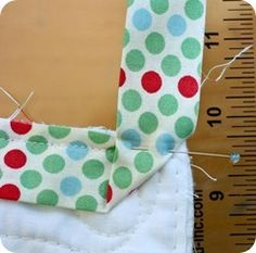 Binding tape around corners, two ways. And finishing the binding where it meets the other end. Great tutorial!