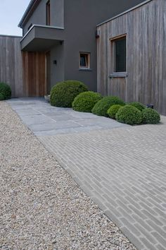 Brick, pebbles and concrete pavers: a harmonious material combination with a tim. - Brick, pebbles and concrete pavers: a harmonious material combination with a timeless, contemporary - Driveway Design, Driveway Landscaping, Backyard Pavers, Stone Driveway, Gravel Driveway, Clay Pavers, Concrete Pavers, Concrete Blocks, Landscape Materials