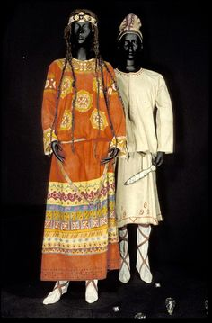 Costume for an Ancestor in scene 2 of the Ballets Russes production of Le Sacre du Printemps 1913.    The costume consisted of a full length robe of off white flannelette, painted at neck, elbow, wrist and hem with geometric shapes in yellow, reddish orange, highlighted with magenta. This was worn with a leather belt and white linen boots under cross strapped leather sandals/boots.    The scenery and costumes were designed by painter, philosopher and archaeologist Nicholas Roerich (1874-1947).
