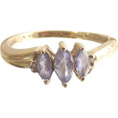 Vintage Ten Kt Yellow Gold with Three Marquise Light Tanzanites  size six and three quarters