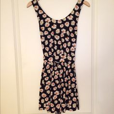 Forever 21 Daisy Romper This daisy romper from forever 21 is so adorable! It ties in the back and fits comfortably. It is a size small but is loose and fits like a medium. Perfect with some cute sandals and a sun hat! Only worn twice. Forever 21 Other