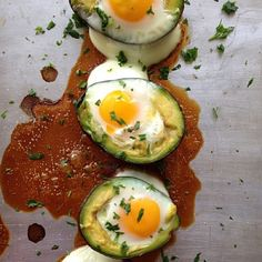 .@myhealthydish_   2 avocadoes, 4 eggs, salt, lime and cilantro.Cut avocadoes in half place on a...