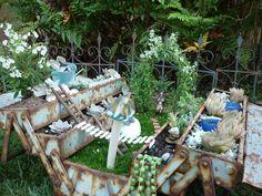 Fairy garden in vintage tackle box