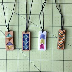Next are these cross stitched laser cut pendants.The pendants measure .5 x 1.5… Cross Stitch Embroidery, Embroidery Art, Cross Stitching, Cross Stitch Patterns, Laser Cutting, Laser Cut Wood, Laser Cut Felt, Wooden Jewelry, Laser Cut Jewelry