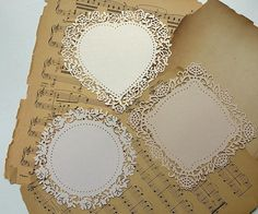 These twelve (12) intricately die cut paper lace doilies are truly unique and beautiful items for vintage-style paper crafting. They measure 5.5 inches each direction and come in 3 vintage hues of off-white to light beige. This set has a slight, metallic sheen to each piece when it catches the light. The intricately laser-cut borders act to frame whatever you put inside such as photos or stamped artwork, die cuts, etc. There are four (4) of each shape: Heart, circle and square. They are of…