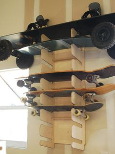 The Soto8 in use.  This 8 board rack is wall mounted and is holding a snowboard, a mountain board, longboards and a skateboard.