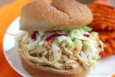 With a five-ingredient sauce you mix directly in your slow cooker, these North Carolina-style barbecue chicken sandwiches are super easy and so delicious!