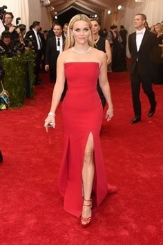 2015 Met Gala: Reese Witherspoon is wearing a red strapless Jason Wu gown with a slit. I like the simple silhouette but the color and slit are both hot! Reese is glam and elegant in red! Gala Dresses, Red Carpet Dresses, 2015 Dresses, Reese Witherspoon, Beautiful Dresses, Nice Dresses, Met Gala Red Carpet, Red Gowns, Costume Institute