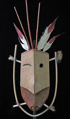 Seal mask  Inuit people, Western Alaska  13.5 inches, wood, reeds, feathers, fur  An important part the shaman's rituals or a religious dance, masks made by the Inuit often represent the sun, moon, people, and many different kinds of animals.