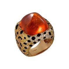 @cartier Étourdissant ring, featuring a 40.69 carat sugarloaf orange spessartite garnet, black lacquer, orange diamonds, yellow diamonds and white diamonds, set in rose gold