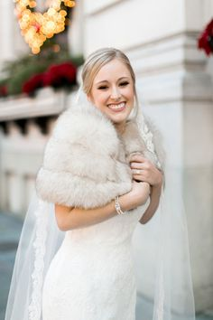 Glam winter wedding dress idea - fitted ivory lace gown + fur shawl {Arte De Vie}