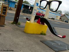 Mustache rides; Interactive kinetic street art in front of El Chilito (tacos) in Austin, Texas