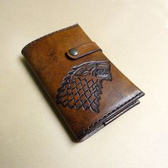 Hand-tooled House Stark dire wolf leather notebook + other Killer Game of Thrones items on Etsy