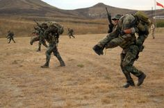 """house-of-gnar: """"CAMP PENDLETON, Calif. SEAL Qualification Training students from BUD/S Class 268 perform buddy carries between stations during a shooting test at Camp. Navy Seal Workout, Navy Seal Training, We Are The Mighty, Ranger School, Camp Pendleton, Us Navy Seals, Six Month, Military Men, Military Weapons"""