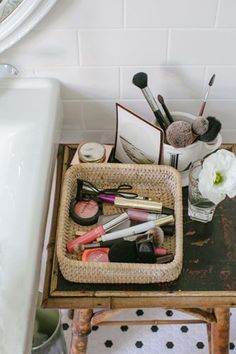 Everyday makeup in a simple basket from Crate & Barrel. You can find similar options at any craft store or flea market. The small size and shallow depth help me to keep my daily staples under control, which is no easy task! When things start overflowing, I know it's time to downsize. The basket lives in my bathroom where I also keep my brushes in a mug from Anthropologie
