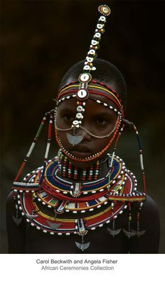 Africa   Beautifully adorned Maasai girl with beaded necklaces and headbands. Northern Swahili Coast   ©Carol Beckwith and Angela Fisher