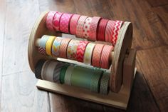 Our new washi wheel is a great way to keep your favorites close at hand and is super cute and colorful sitting on your workspace.    Each wheel will hold up to 72 rolls of washi tape.