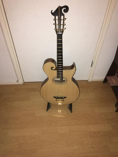 My version of a Gibson style O Artist. Built as a flat top. Black walnut back and sides, spruce top, ebony fingerboard, 12 fret. I installed an experimental Virzi tone producer. Very resonant loud guitar with a jazzy punch