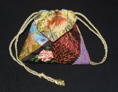 I ❤ crazy quilting . . . CQ Origami pouch (step by step)-  Here is my second bag for the Paisley Bauble Bag swap over at CQN. These first two pics are of the pouch, completed, and the draw cords pulled.