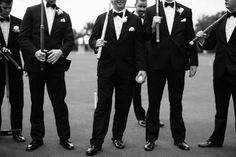 Groom and groomsmen in tuxedos get ready to play a game of croquet before wedding.