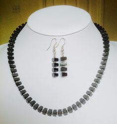 Hematite triangles combined with silver delicas