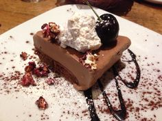 Chocolate almond ice cream pie with almond cream and cherry candied popcorn at Zest, Leipzig.