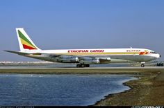 Ethiopian Airlines Cargo Boeing 707-327C ET-AIV bathes in the sunlight after a period of heavy rain and flash flooding at Dubai-International, March 1996. (Photo: Perry Hoppe)