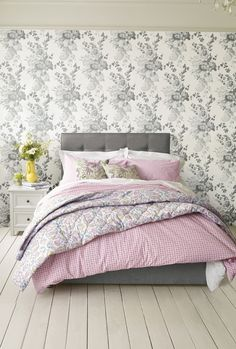 If you love mixing prints, go for a printed wallpaper, a simple printed bedding and printed throw. Keep the theme and colours similar, for instance florals and pinks!