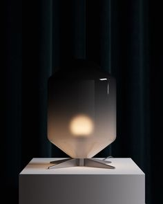Modern table lamp with a soft, ombre geometric silhouette
