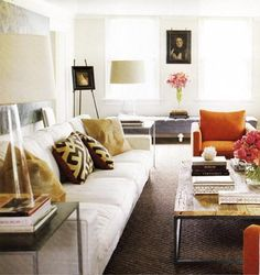 Orange and lavender, love a four-cushion sofa for generous seating arrangements.