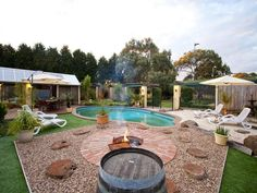 Love it! Don't want the grass, would concrete there. Would do seating around the firepit and enlarge the pit too.