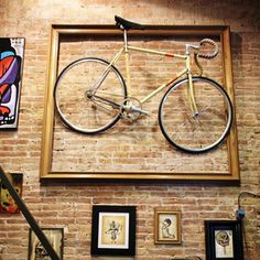 creative vintage bicycle displays in the home | This massive frame surrounds a vintage bike to make a large focal ...