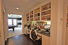 I like this for a family office...and WOW...look at the game room!