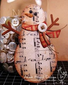Sizzix snowman, made with chipboard and sheet music... Fa la la la la! by shelby